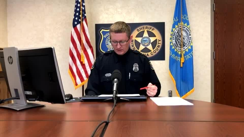 Police spokesman Sam Clemens goes over the call log during Friday's briefing.