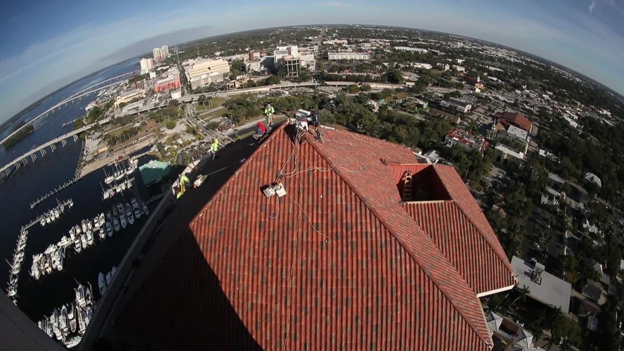 Perched 32 stories high, High Point Place roof in downtown Fort Myers being replaced