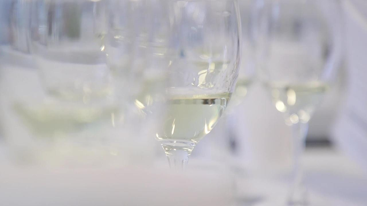 Wine makers taste wine in azcentral competition