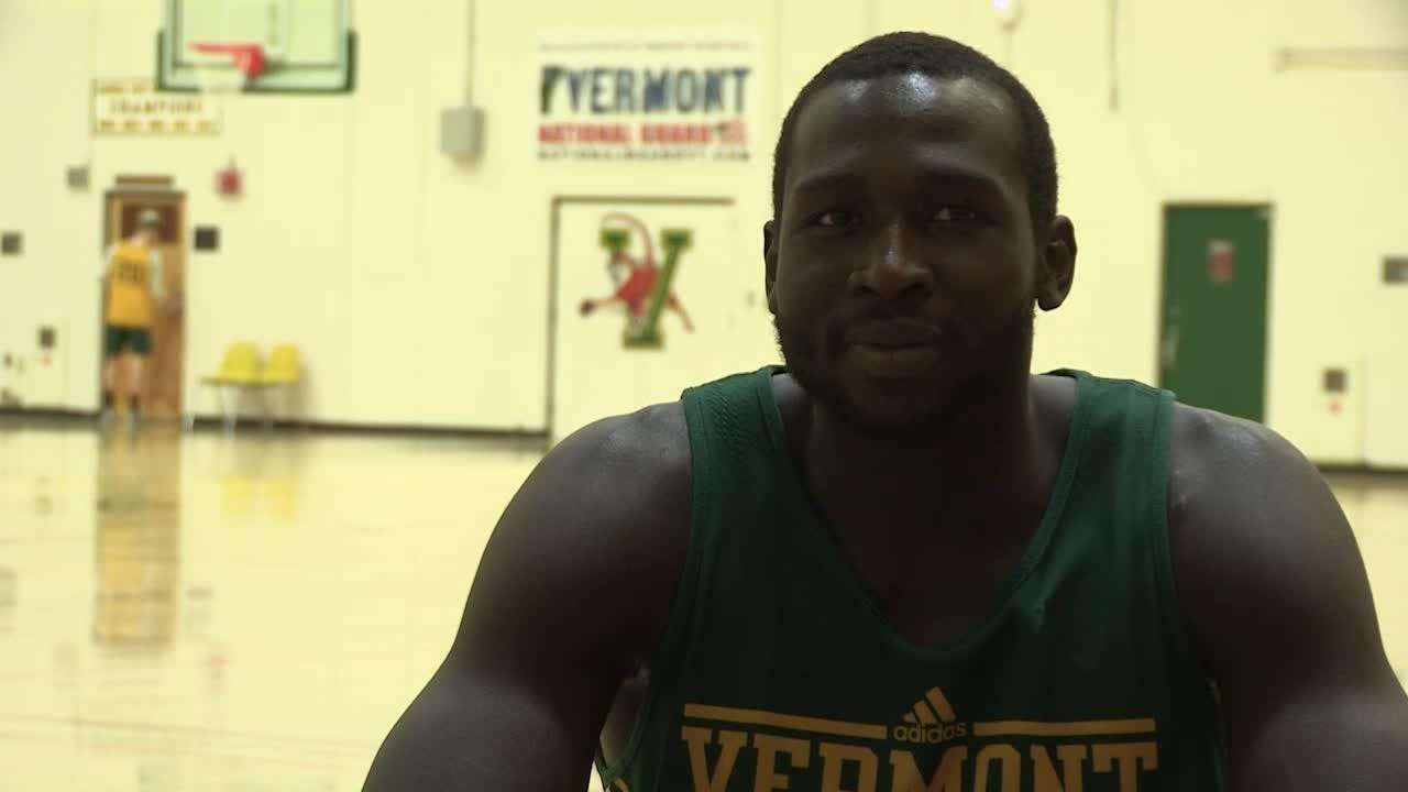 UVM men's basketball senior Samuel Dingba returned home to Cameroon two years ago to donate food and supplies in his native country.