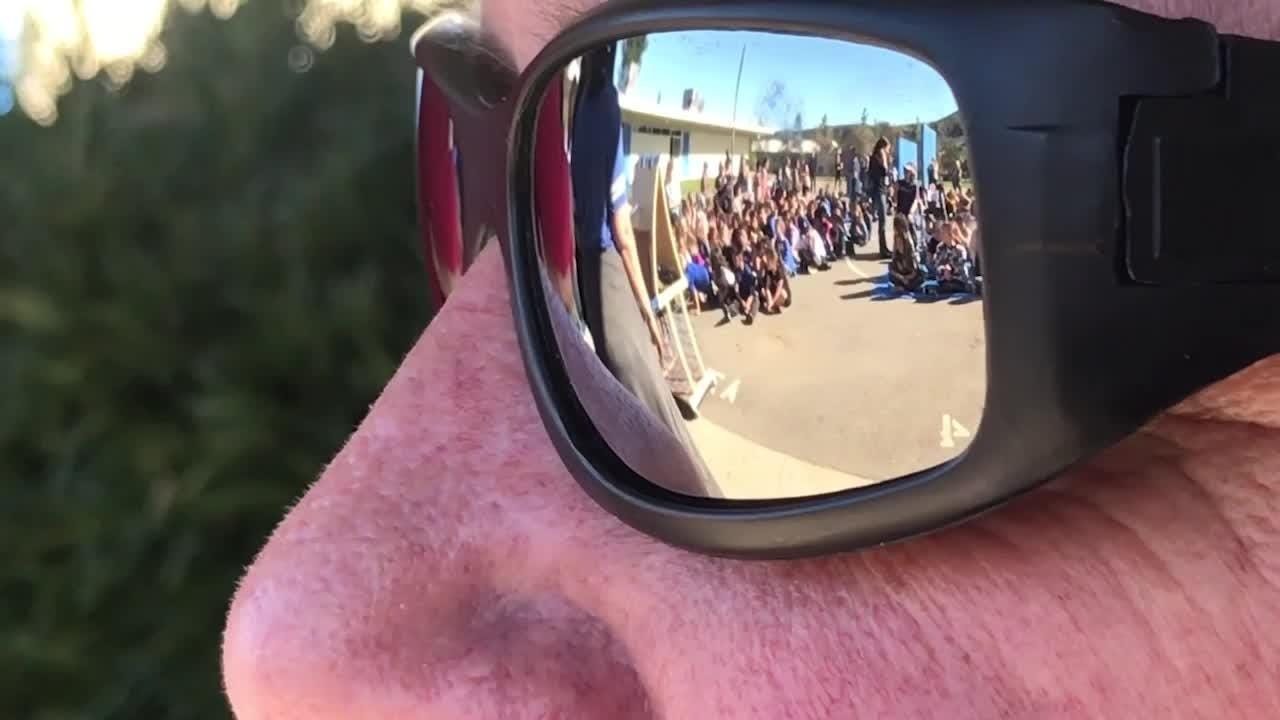 Bob Belanger, a Simi Valley crossing guard hit by a car and injured last October, was honored by Madera School at a ceremony to promote safe driving.