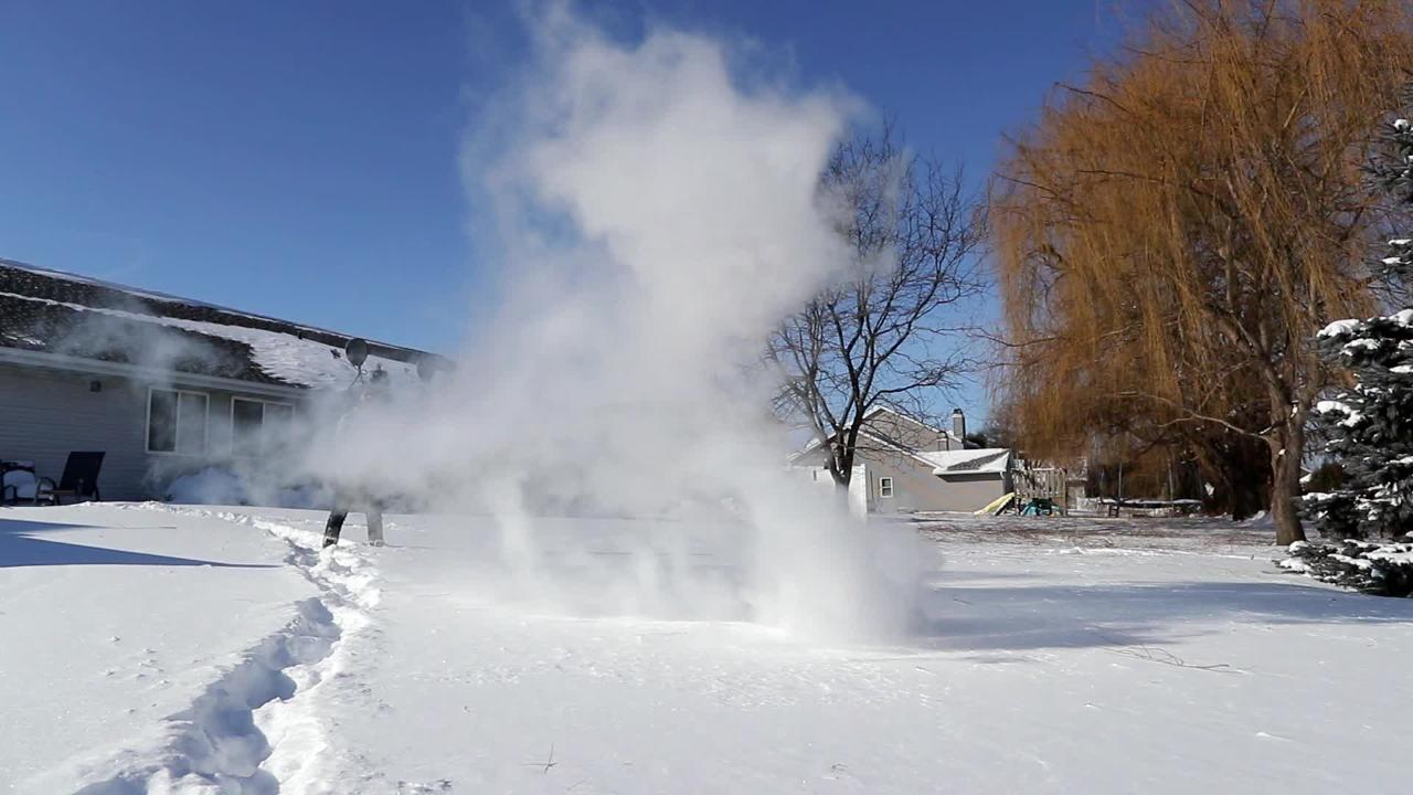 Boiling water thrown into the frigid Wisconsin air instantly turns to steam.