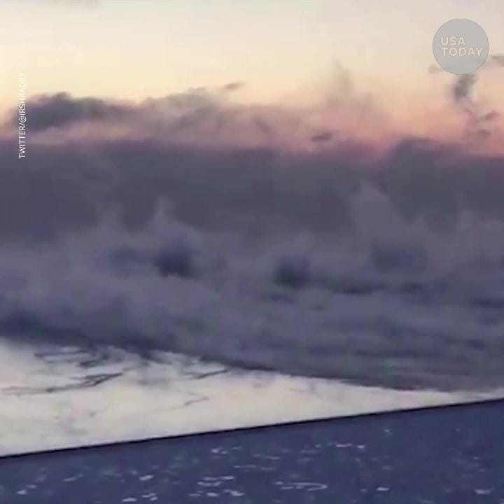 Frigid weather causes steam to rise from Lake Michigan.