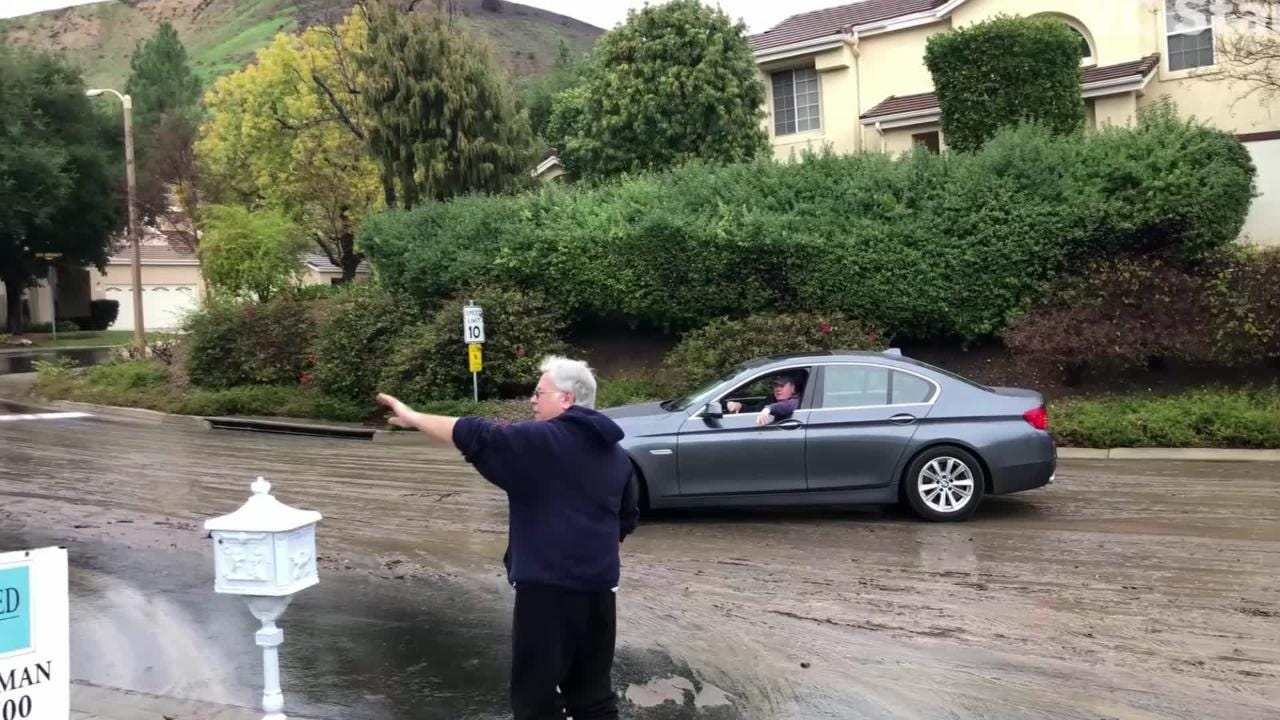 Jerry Lax of Westlake Village explains how mud gushed into his yard as a major storm passed through the region.