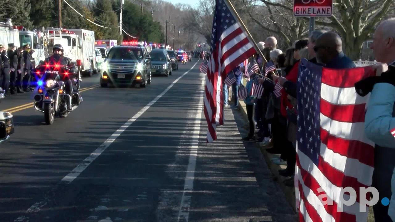 The Fair Haven community lines Harding Road to pay their respects to Army Pfc. Jamie R. Riley, 21, who died in a military training crash.