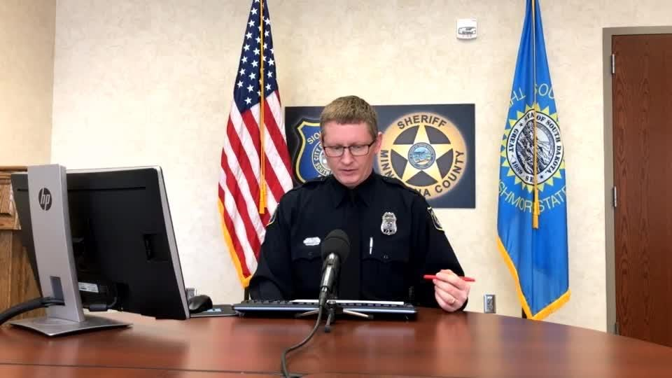 Police spokesman Sam Clemens goes over the call log during Monday's briefing.