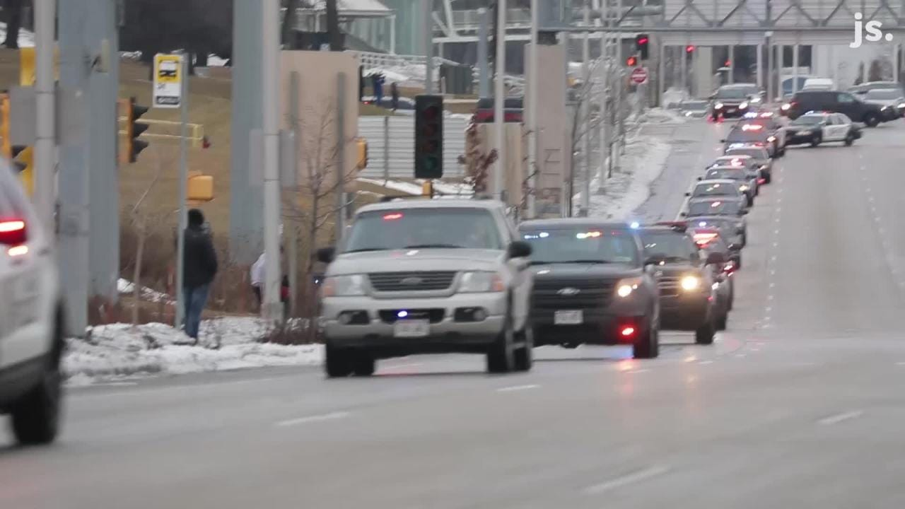 Procession with fallen Milwaukee police officer leaves Froedtert Hospital for medical examiners office.