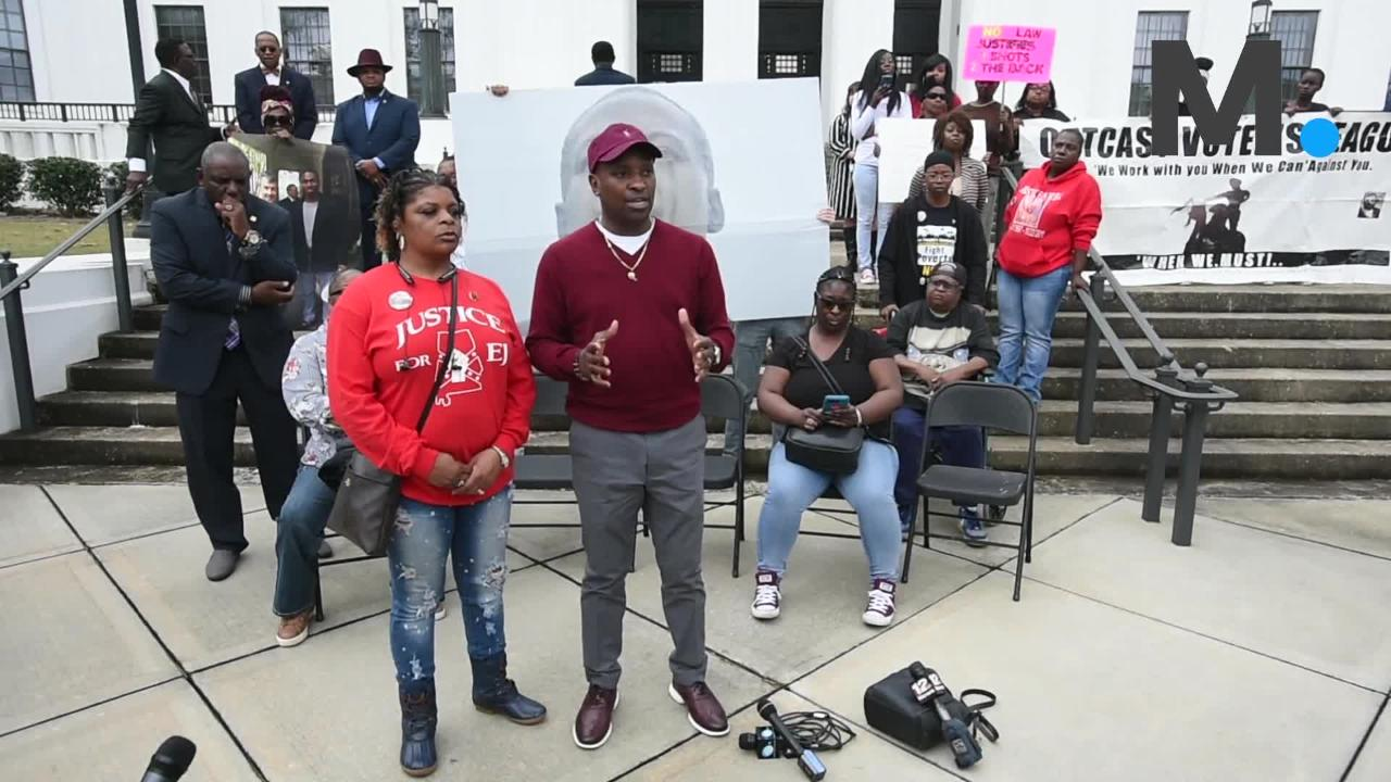 EJ Bradford's father speaks in front of A.G. office