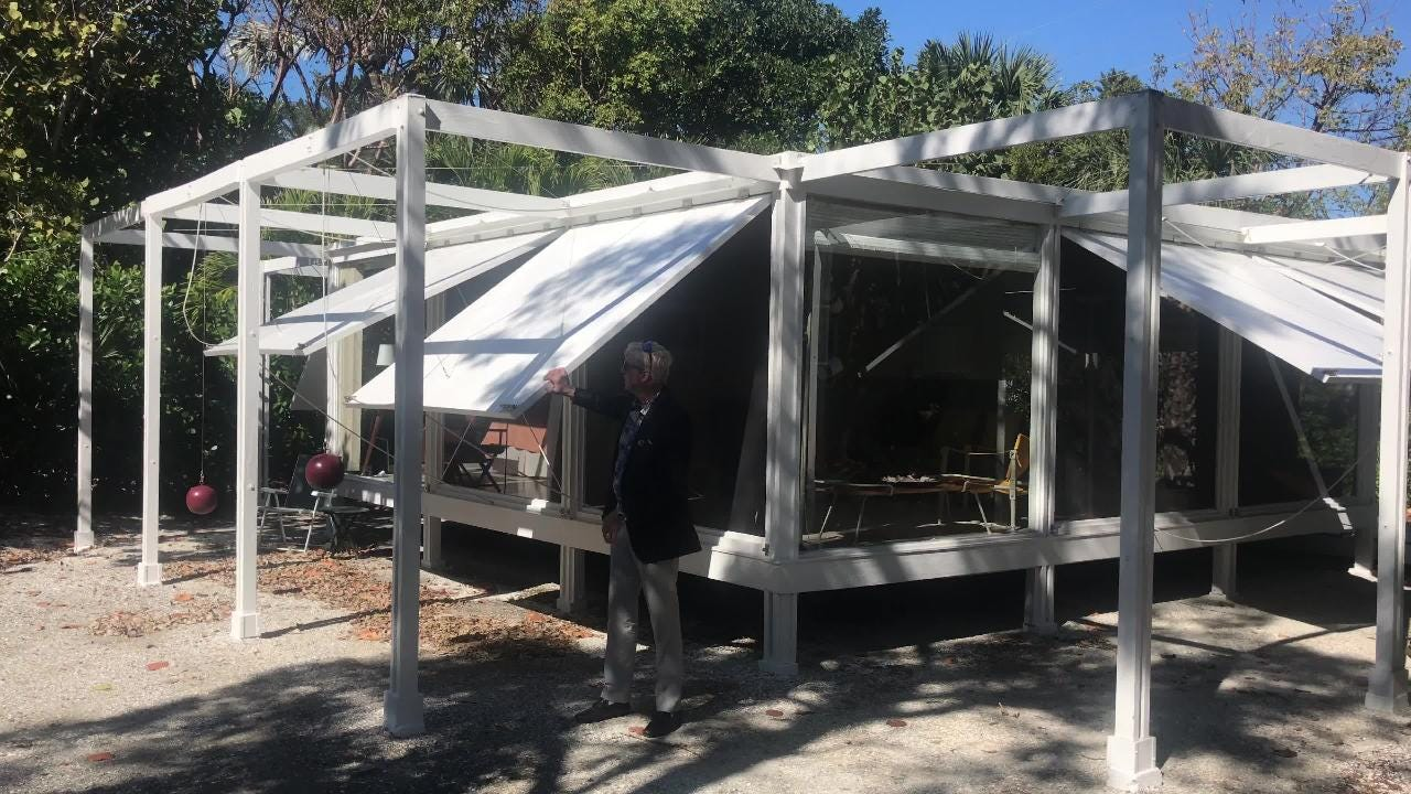"""The Walker Guest House on Sanibel is also known as the """"Cannonball House,"""" for the red, steel, cannonball-shaped weights that are part of the panel-raising mechanisms."""