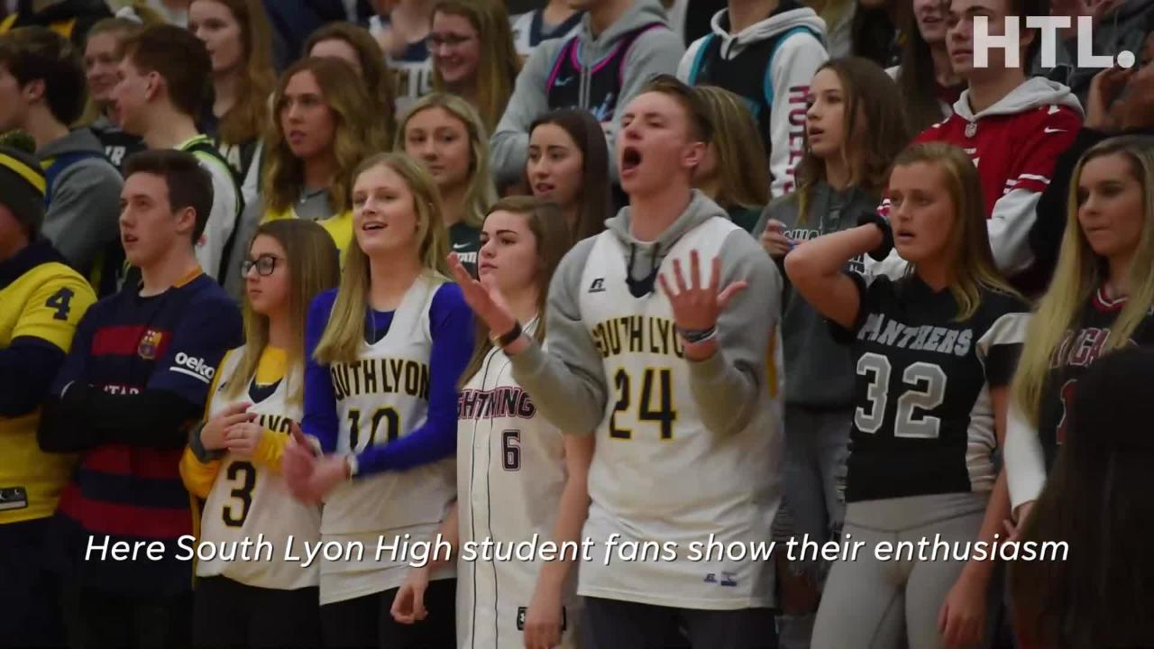South Lyon High School hoops fans are super energized - watch as they follow the game and show their support for their teams