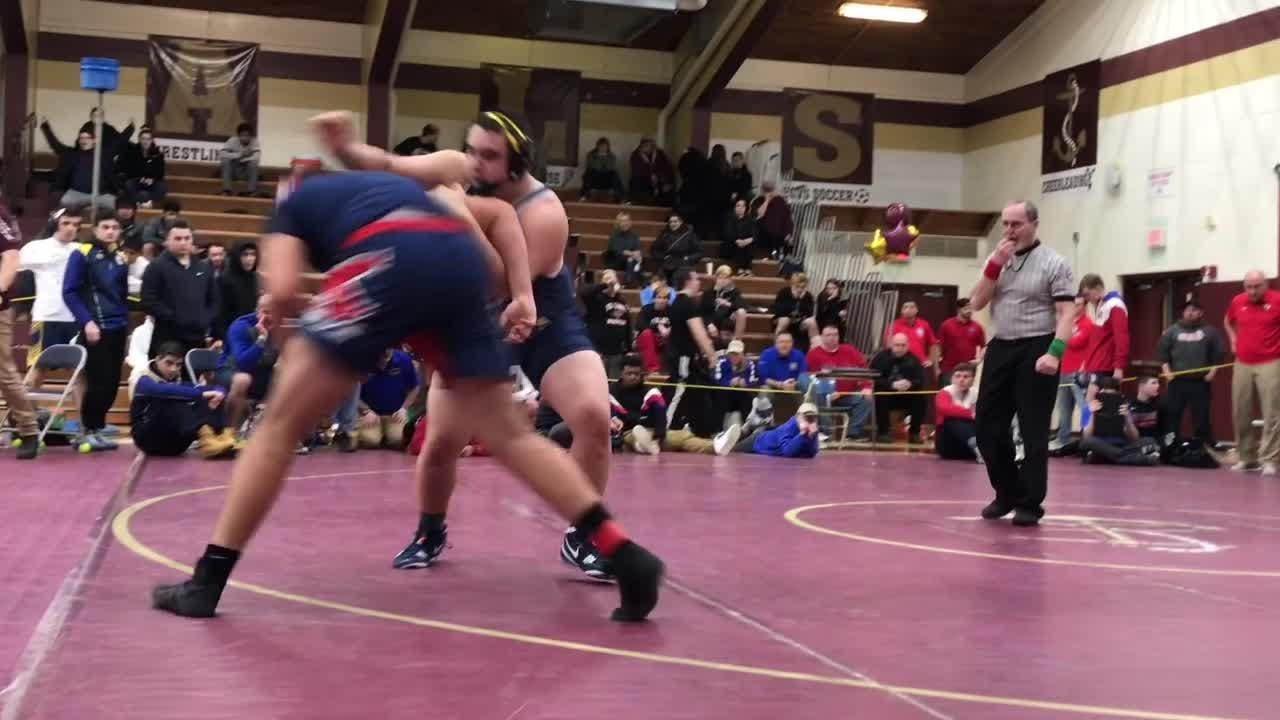 Highlights from the first day of the Section 1 Division I wrestling tournament at Arlington High School