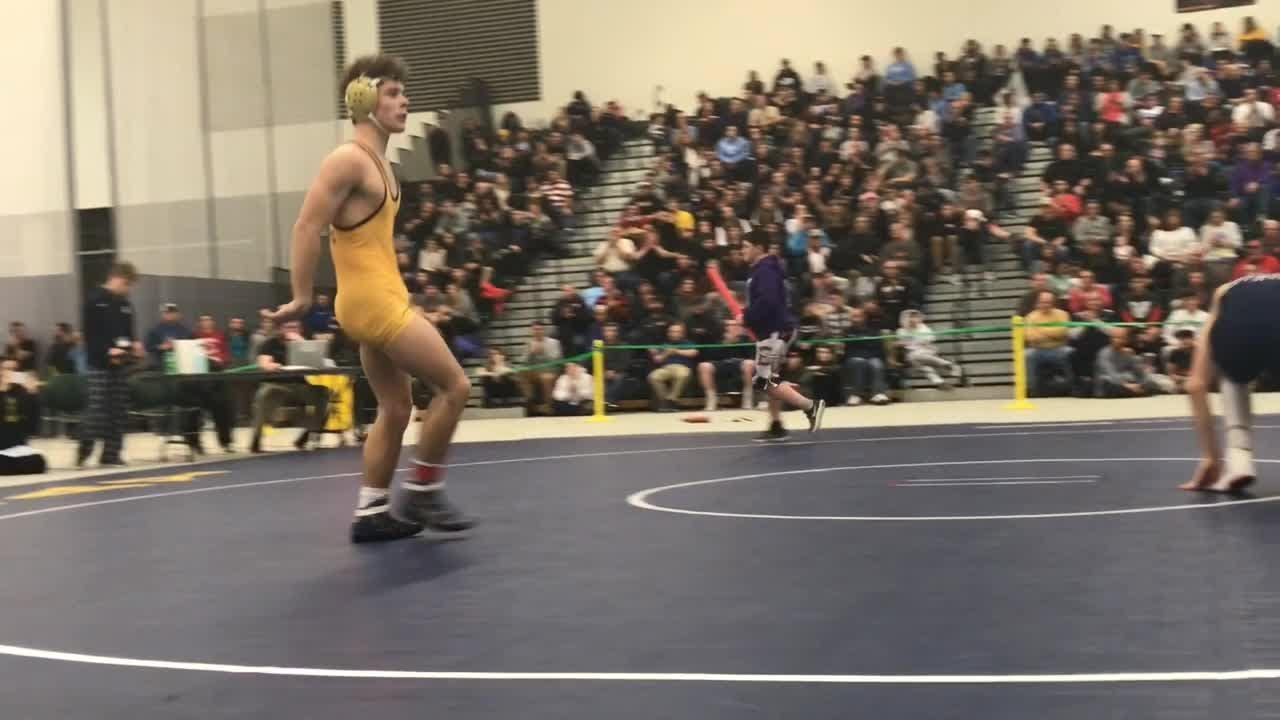 Mason Wersinger, a junior, wins his 190th varsity match at the high school state championships qualifier