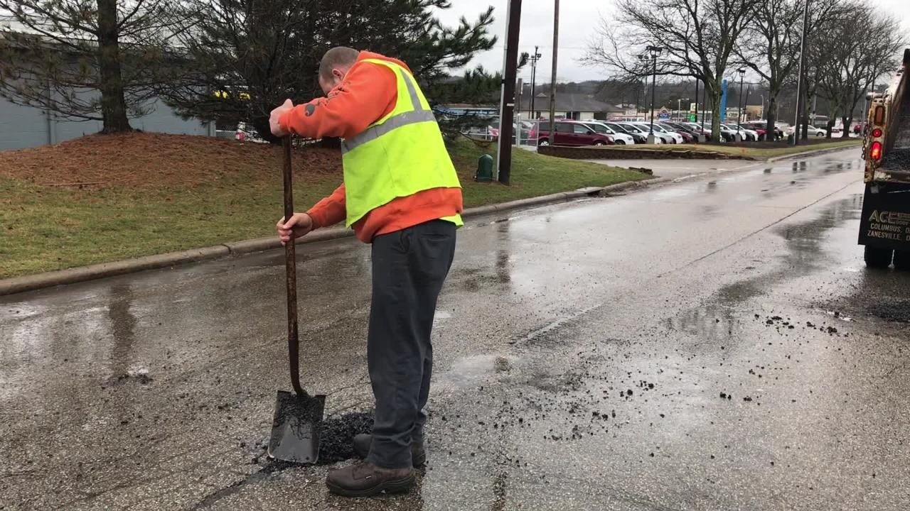 City crews repair a pothole on Brandywine Boulevard on Feb. 12, 2019.