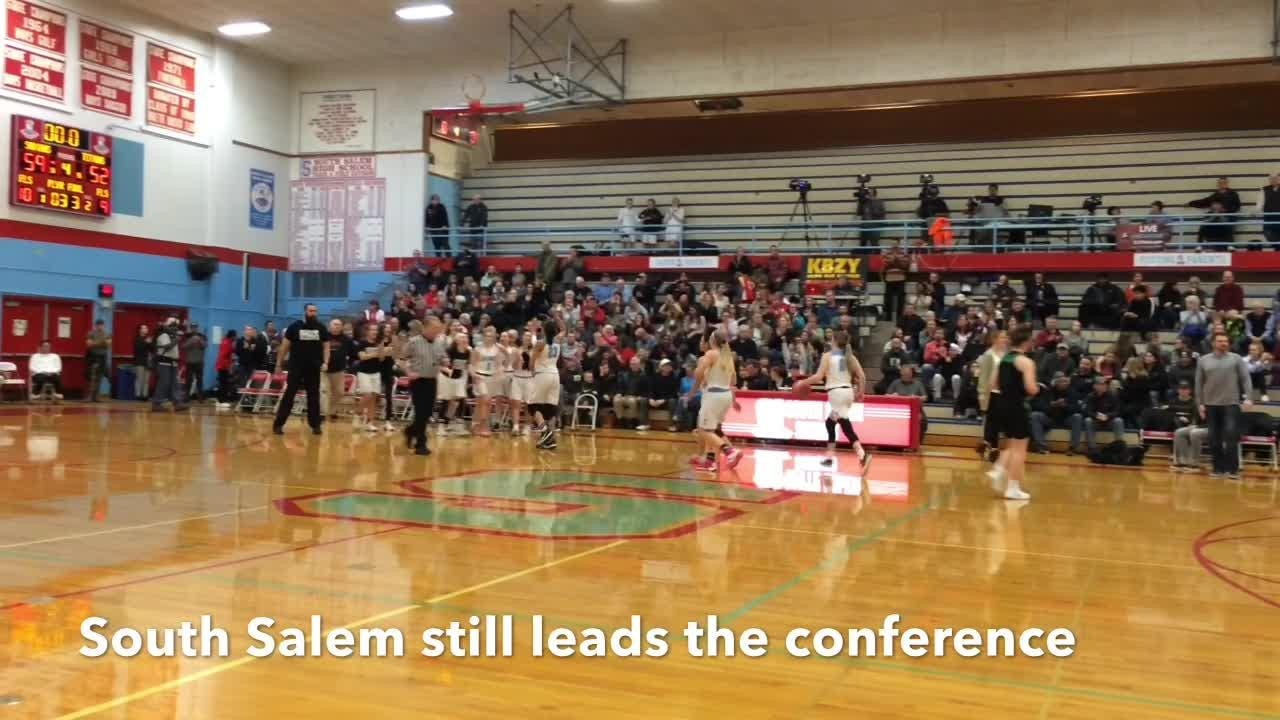 South Salem's girls basketball team beats West Salem 59-52 to remain in first place in the Mountain Valley Conference.