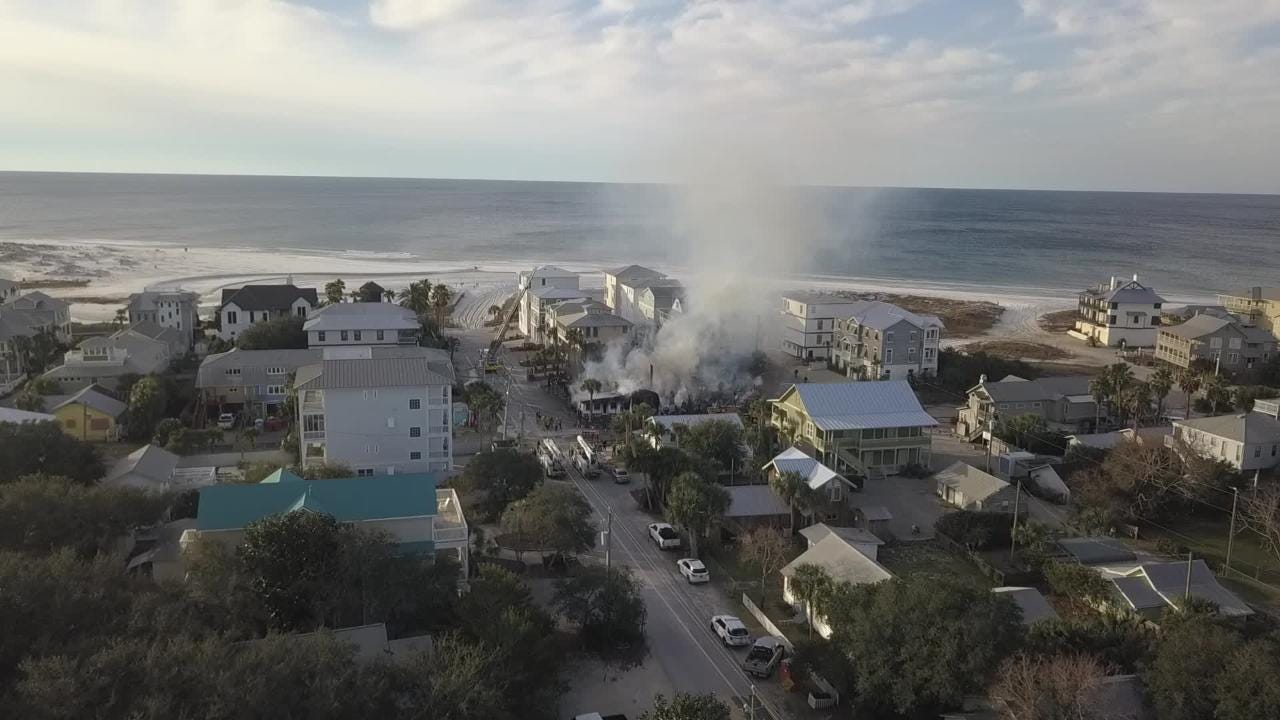 Aerial footage captured by The Beach Club App, Inc. shows the smoldering remains of The Red Bar in Grayton Beach after a fire destroyed the famous bar.
