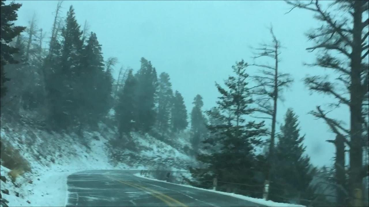 As snow and fell on Ski Run Road, winds were gusting as the dusting of snow could be seen traveling across the roadway, with near whiteout conditions.