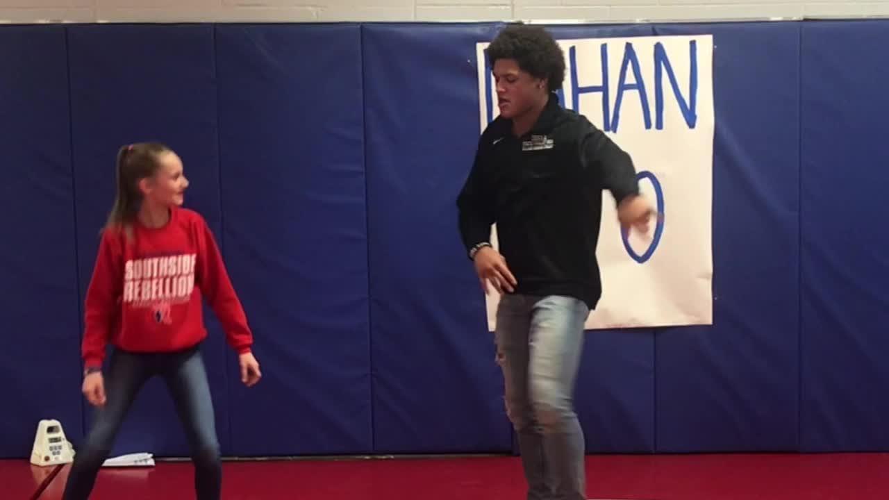 Roncalli football player, state wrestler Elijah Mahan dances
