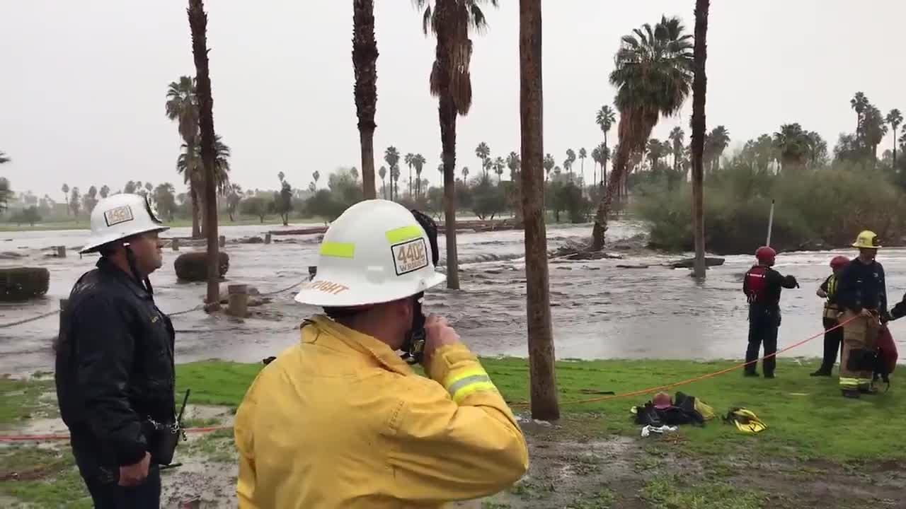 First responders rescue a person who was trapped by swift-moving water at Farrell Drive and Ramon Road in Palm Springs, Thursday, Feb. 14, 2019.