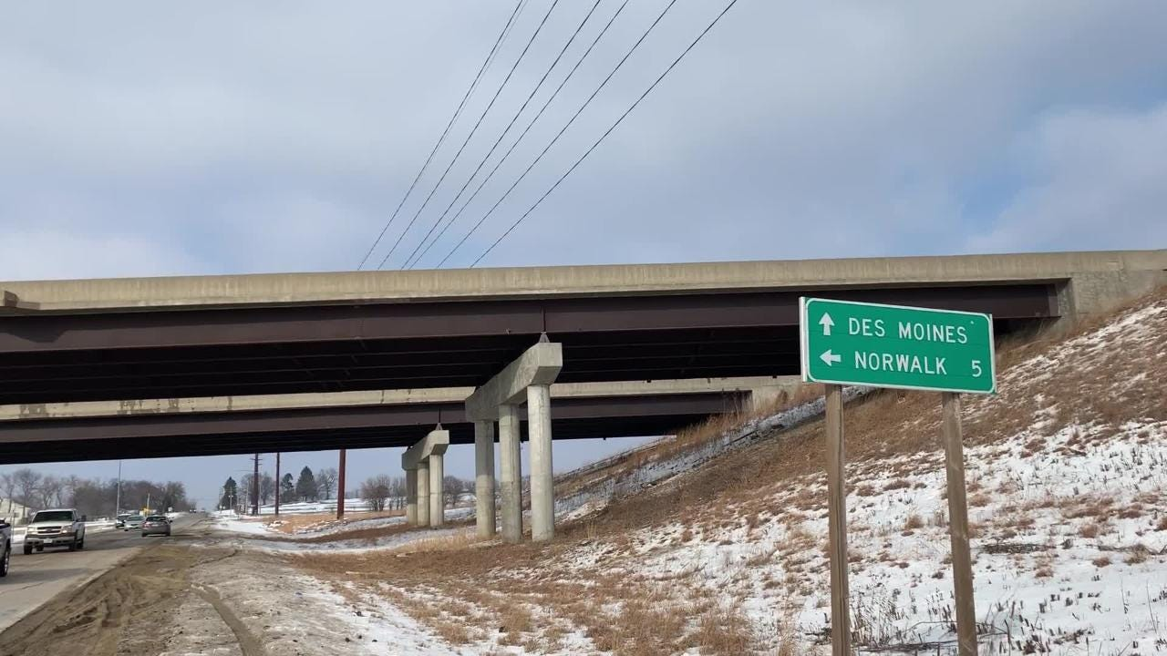 Des Moines police on location Thursday afternoon after a van drove off a Highway 5 overpass and landed on Ninth Street.