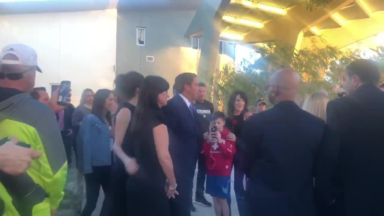 Florida Gov. Ron DeSantis and his wife arrive at Parkland anniversary vigil