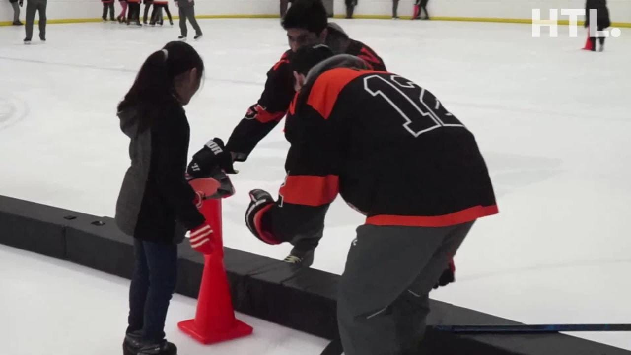 Northville High School boys and girls hockey squads spent a morning with kids from Neinas Elementary in Detroit teaching them some skating basics
