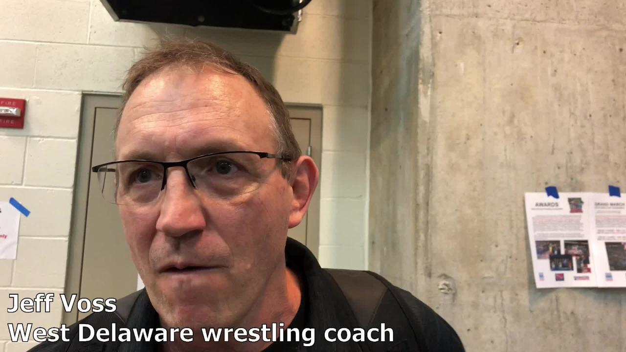 West Delaware coach Jeff Voss talks after the Hawks clinched the Class 2A state wrestling team title on Saturday. It is the Hawks' third state wrestling title.