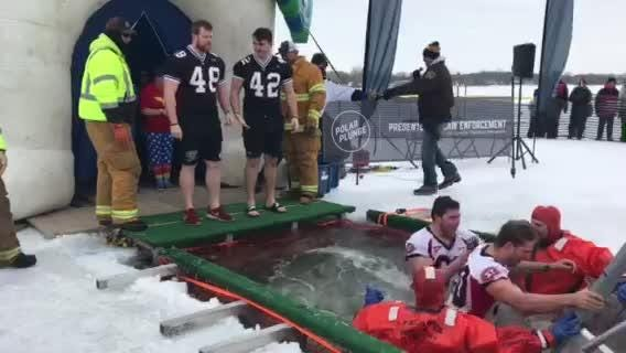 Plungers jump into the icy water at the St. Cloud Polar Plunge Saturday, Feb. 16.