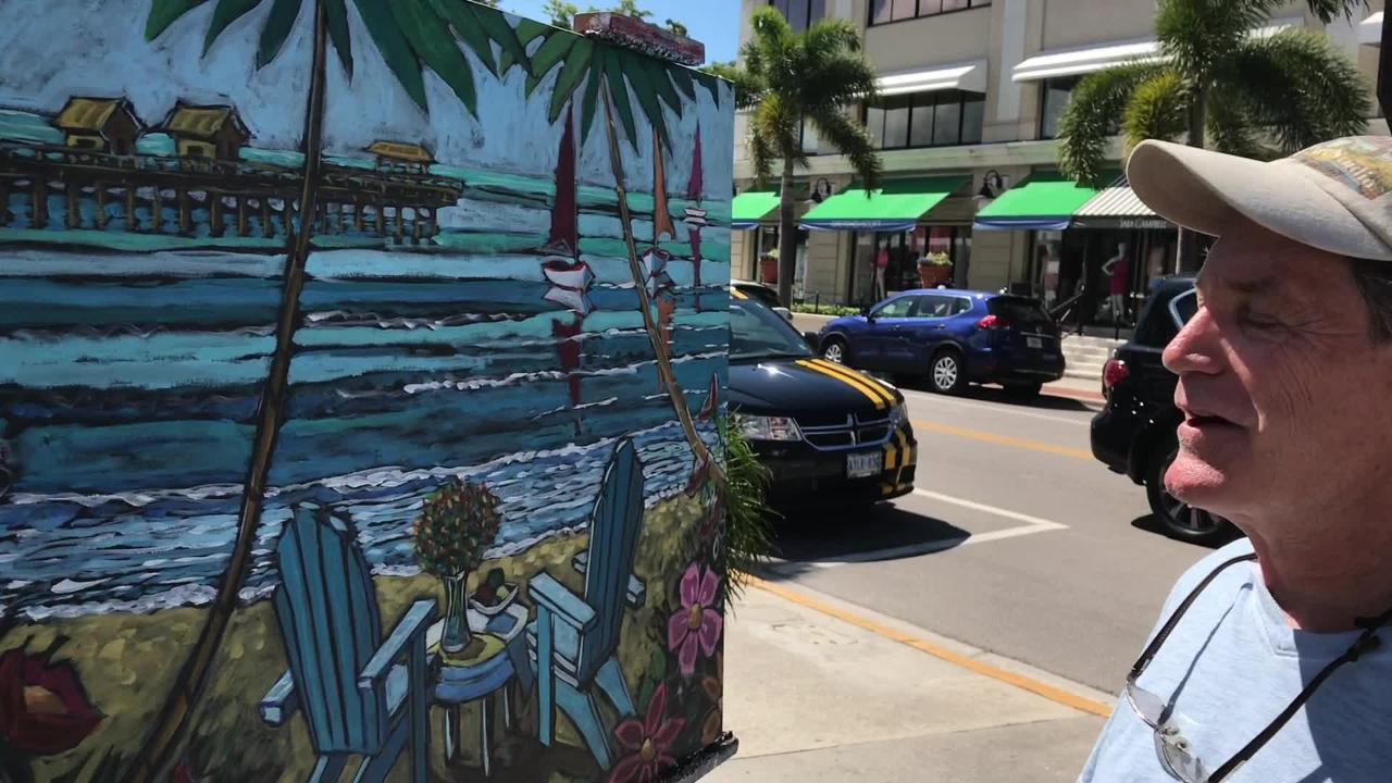 Southwest Florida artist Thom Millsap showcases his newest painting of the Naples Pier to passersby along Third Street South.