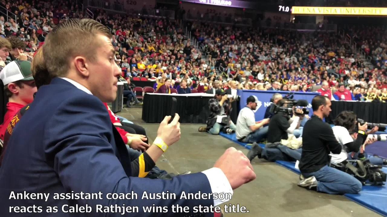 Ankeny assistant coach Austin Anderson watched mat side as sophomore Caleb Rathjen won a state title this past weekend.