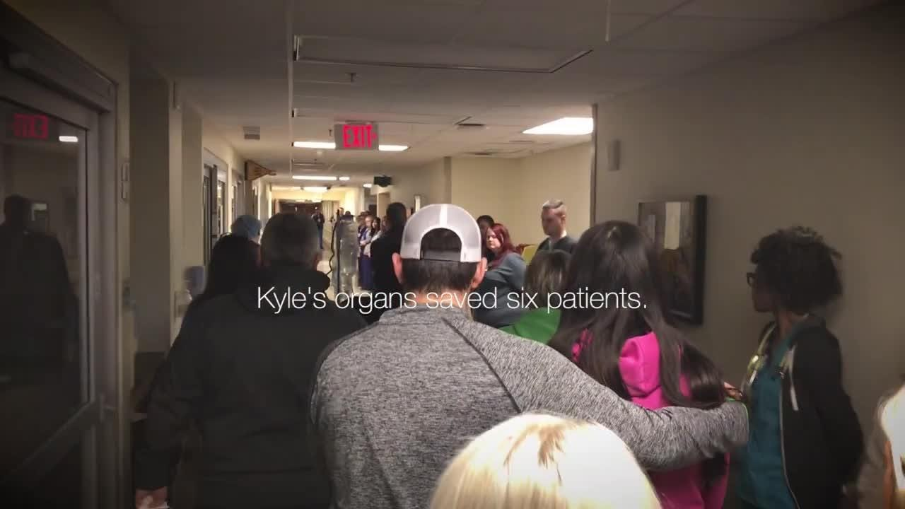 Staff from all over the hospital line the hallways to help an organ donor's family honor his final act of kindness.