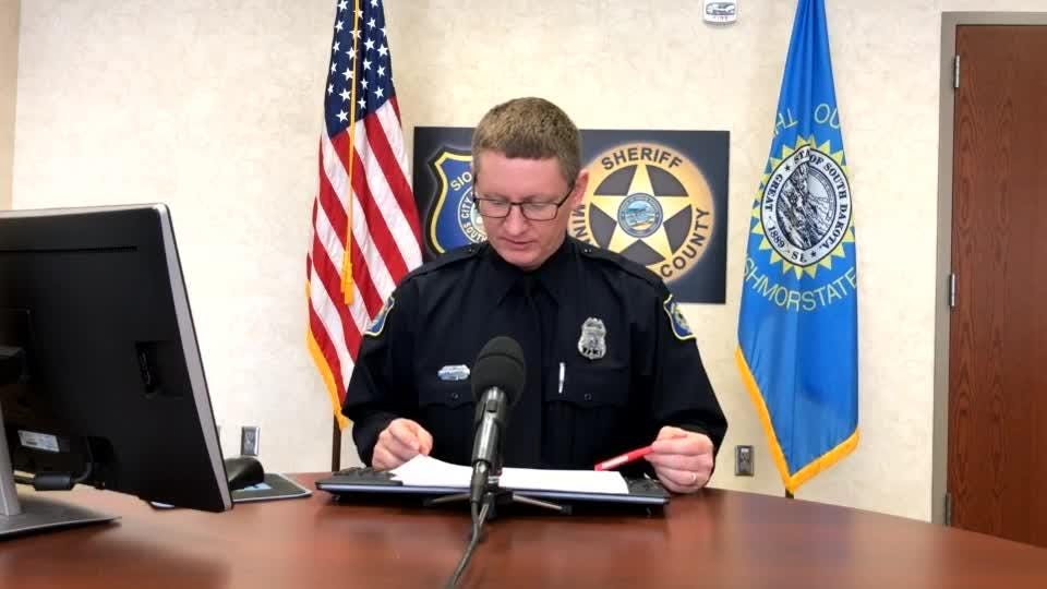 Police spokesman Sam Clemens goes over the call log during Tuesday's briefing.