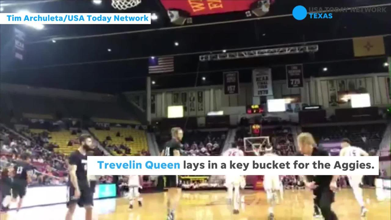 New Mexico State's Trevelin Queen lays in a key bucket for the Aggies