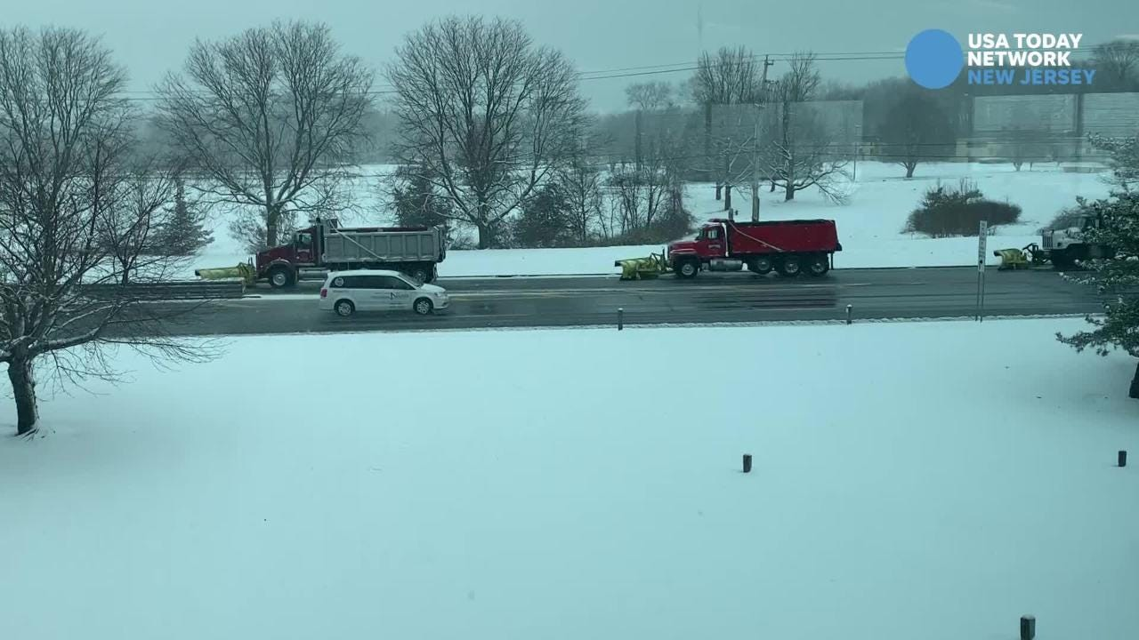 Five snowplows move down Route 66 in Neptune Wednesday afternoon.