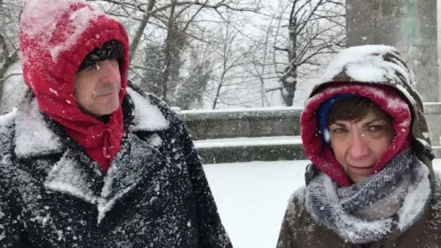 Sue and Bill Getman take a break from walking their dog Chip to talk about the snow.