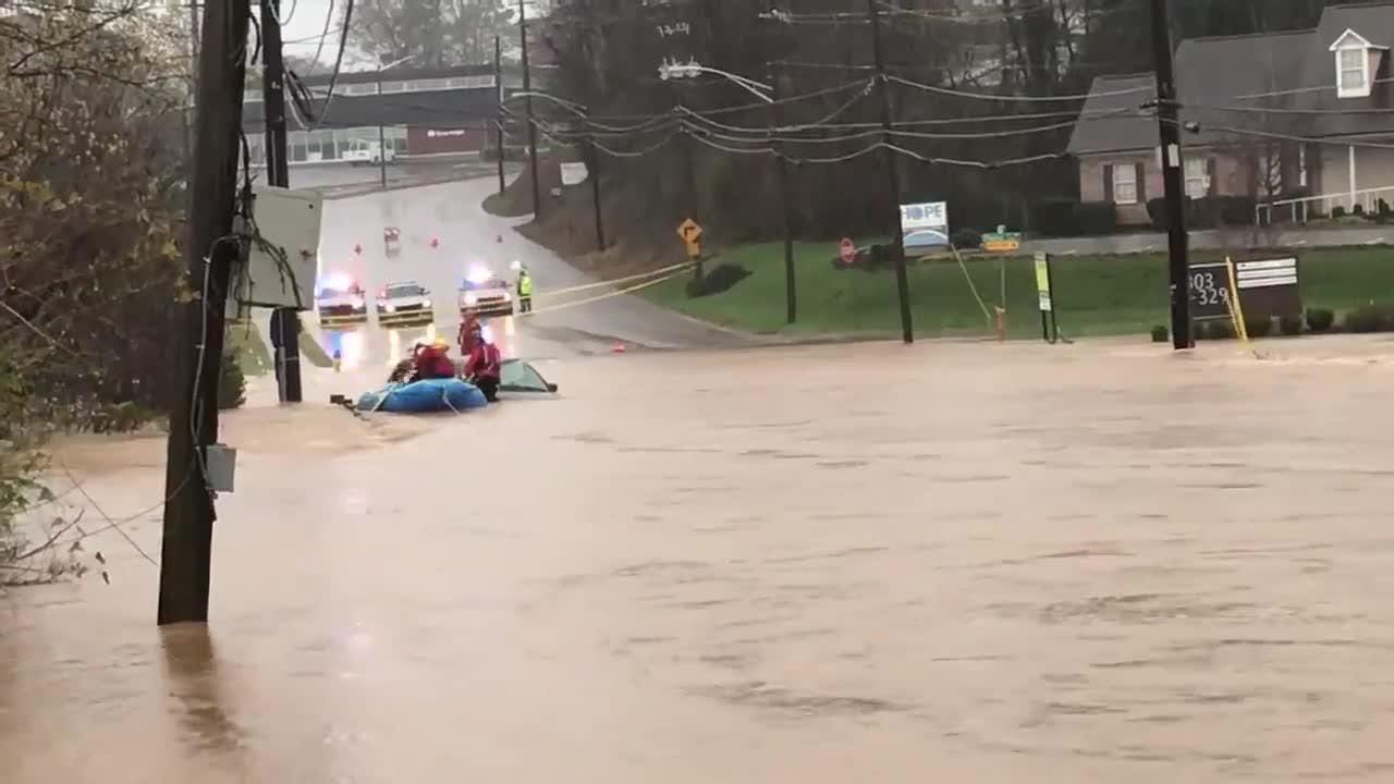 Knoxville Fire crews rescue victims from a van stuck in floodwater at Concord Street.