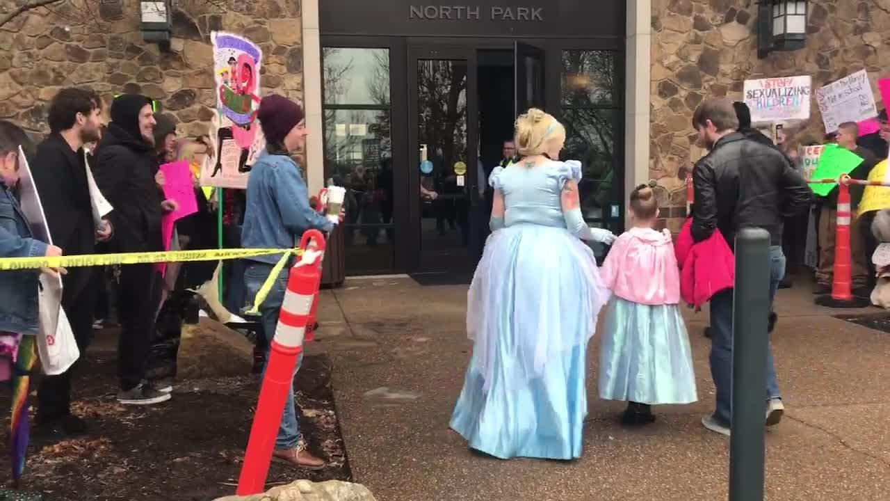A Drag Queen Story Hour supporter dressed as Cinderella crossed the lines to hug a child who came dressed as Cinderella for the reading.