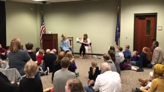 """Florintine Dawn reads """"Brown Bear, Brown Bear"""" to a group of children and parents at EVPL's Drag Queen Story Hour."""