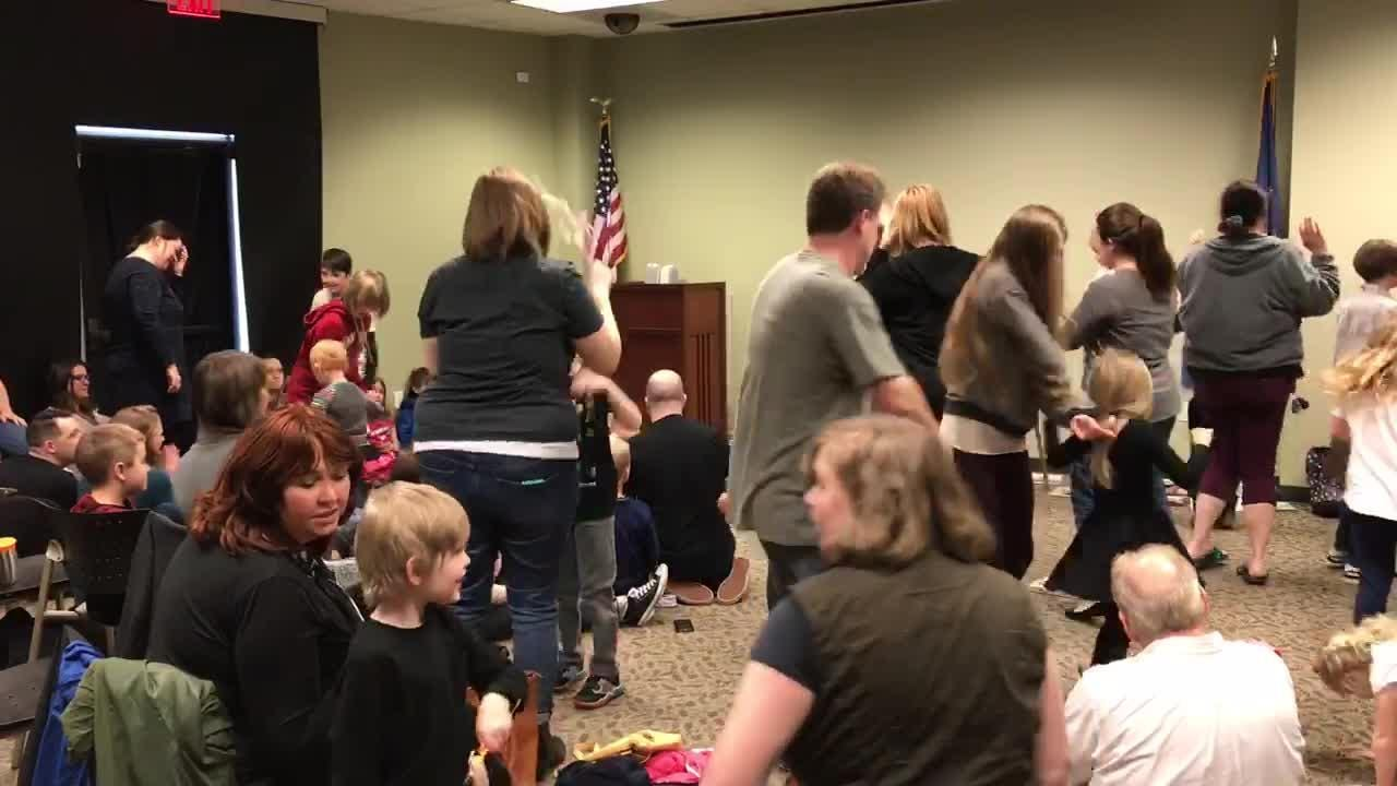 Children and their family members dance along with drag performer Florintine Dawn during Drag Queen Story Hour Feb. 23.