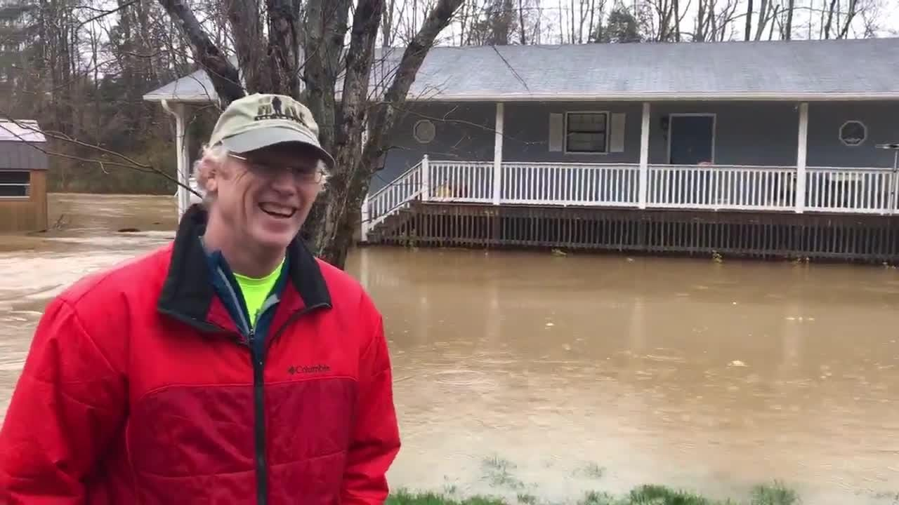 """Boyd's Creek resident Bryan Partridge details the damage done to his home. """"This is my new boat. It was my house."""""""