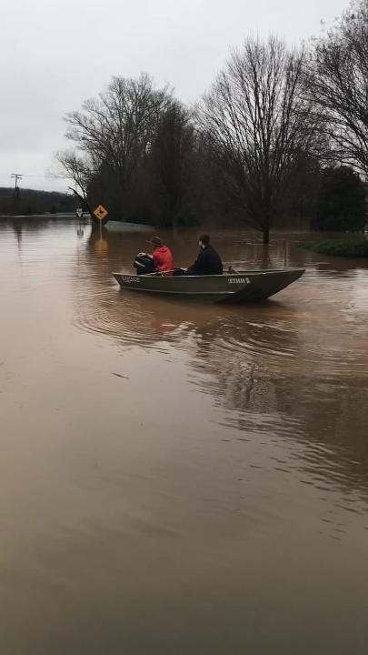 Flooding hit Saturday outside the entrance to the Northshore Hills subdivision, off Northshore Drive near Ebenezer Road in Knoxville.