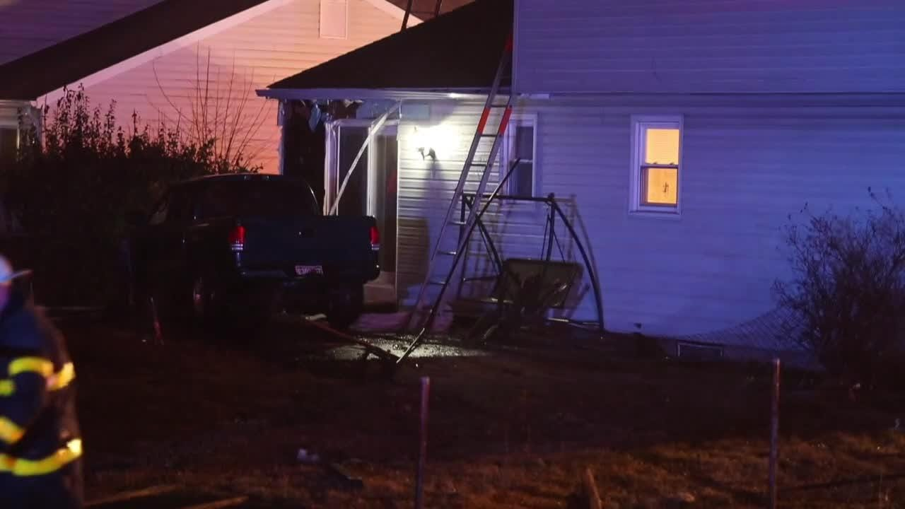 A fire was contained by firefighters after  a pickup truck veered off Basin Road and struck a home on Valley Forge Road near New Castle early Sunday.
