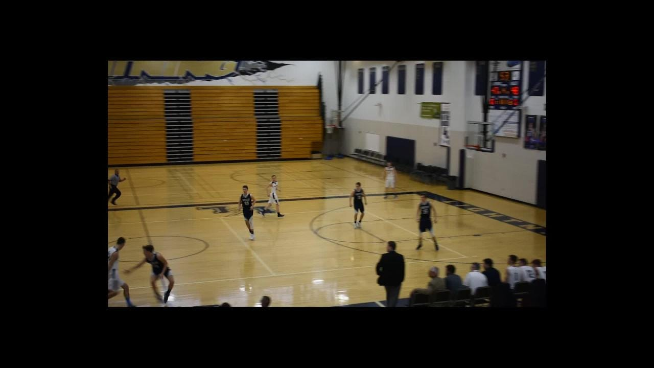 Deric Woods hits a contested 3-pointer at the overtime buzzer to boost Front Range Baptist past Cornerstone Christian 50-48 in overtime. Courtesy FRB.