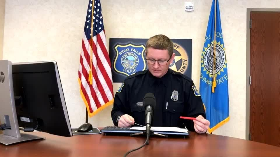 Police spokesman Sam Clemens goes over the call log during Monday's police briefing.