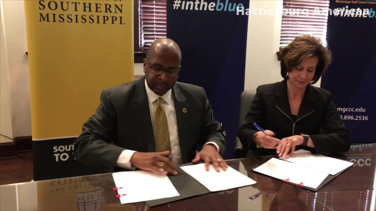 USM President Rodney Bennett and Mary Graham, president of Mississippi Gulf Coast Community College sign an MOU on new teacher program.