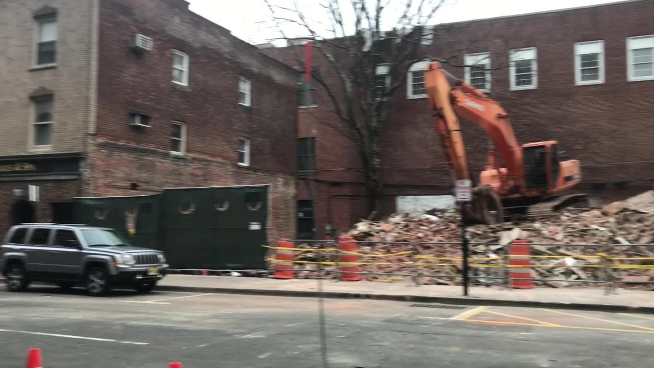 A Market Street building compromised during renovation was demolished overnight February 27, 2019, in Morristown.
