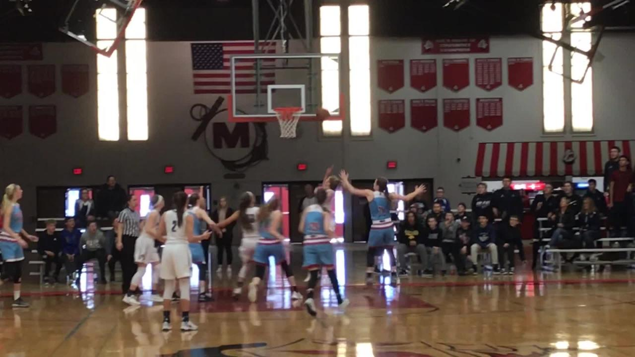Bay Port's Raegan McIntyre scores the game-winning shot in overtime to help the Pirates beat Arrowhead in a WIAA sectional final at Manitowoc.