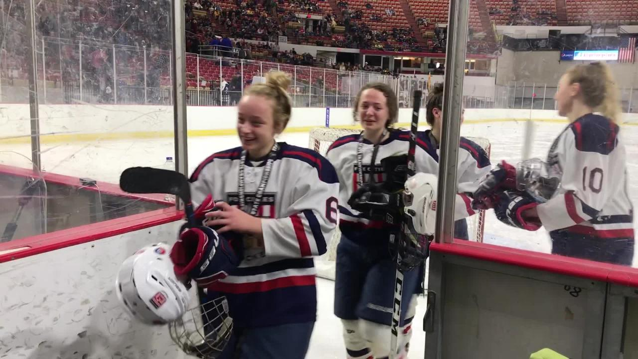 The victorious Fox Cities Stars girls hockey team leaves the ice after beating Hudson to win the state title at the Alliant Energy Center in Madison
