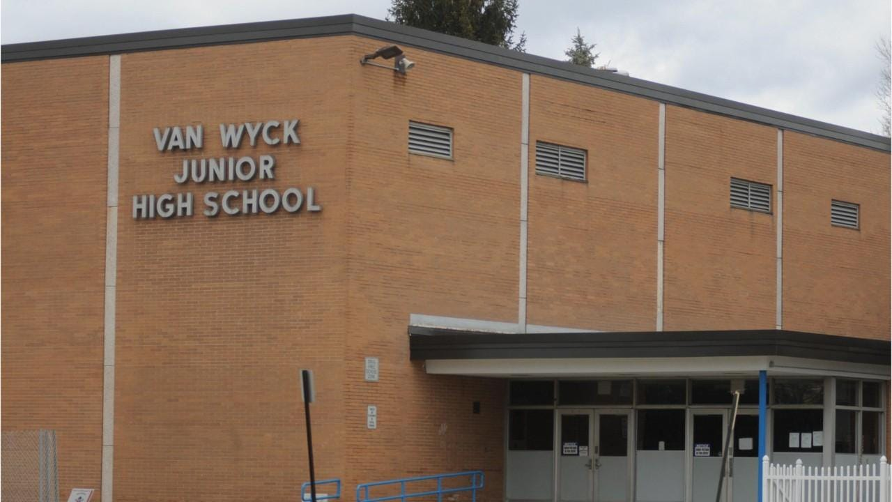 After a mom collapsed in Van Wyck Junior High School, the quick actions of two school nurses saved her life, officials say.