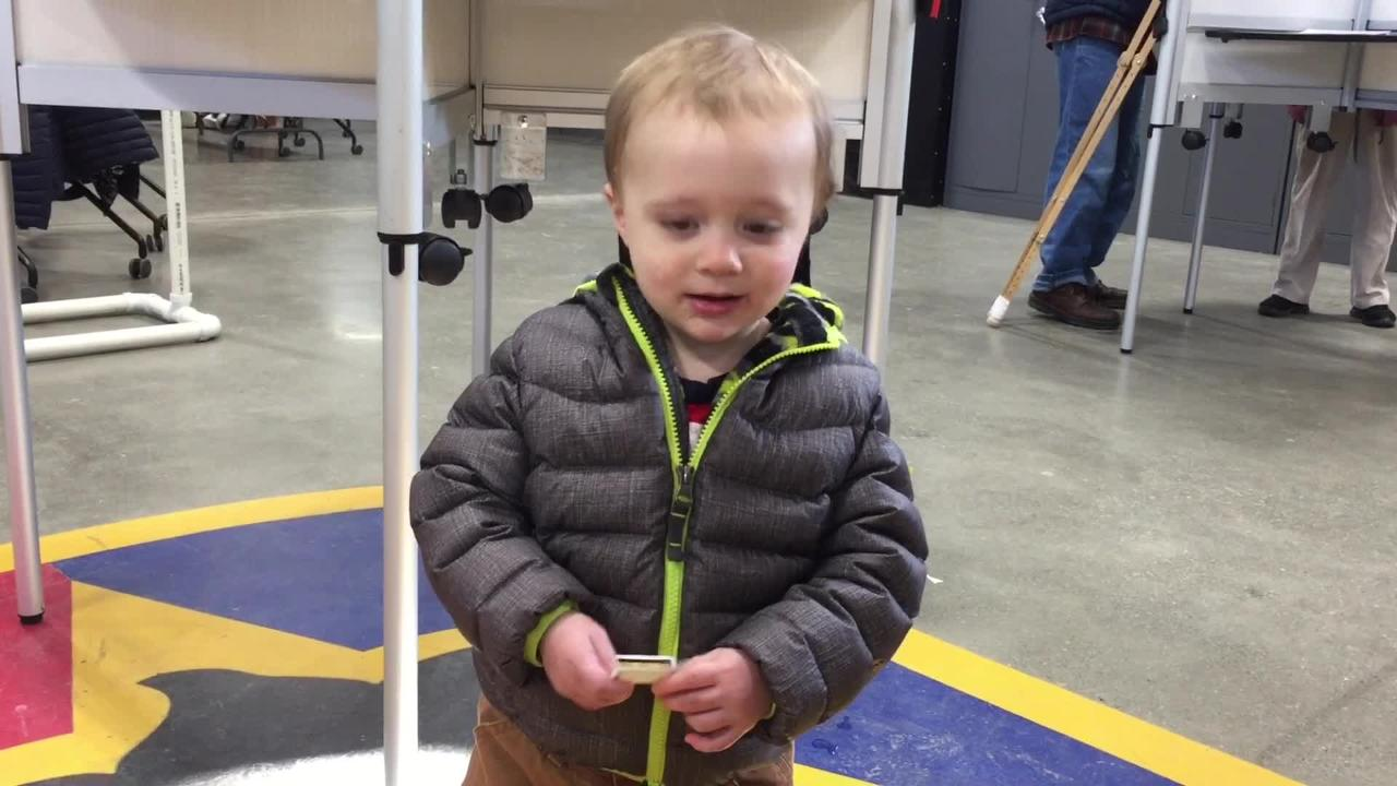 "Williston resident Nick Perkov discusses what drew him out on Town Meeting Day 2019 as his 19-month-old son, Oliver, totes an ""I Voted Today"" sticker."