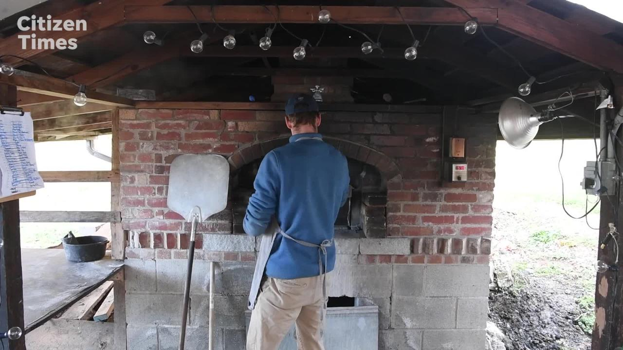 Brennan Johnson bakes bread in a brick oven in Marshall for his community-supported bakery deliveries.